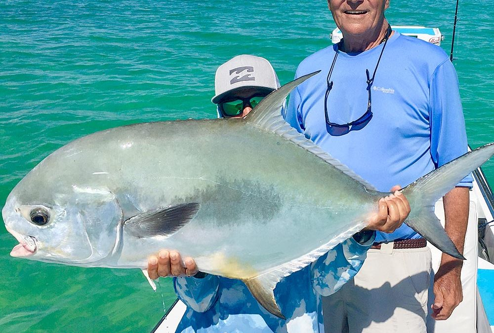 Capt. Gus holds a permit caught on recent visit to Belize.